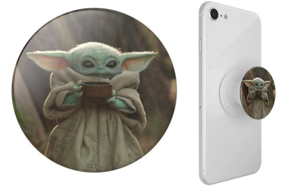 A baby yoda popsocket on a phone