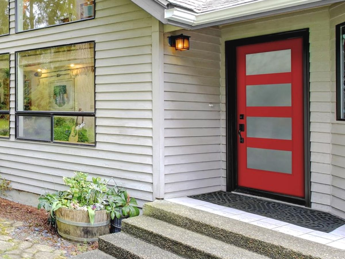 A modern red door on a white house
