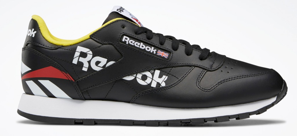 black leather reebok shoe with white and black sole