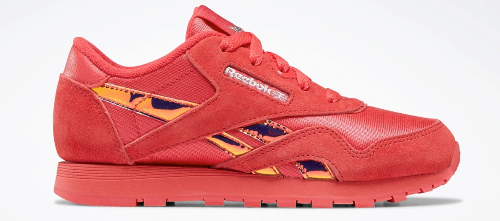 red kids shoe with holographic reebok logo on side