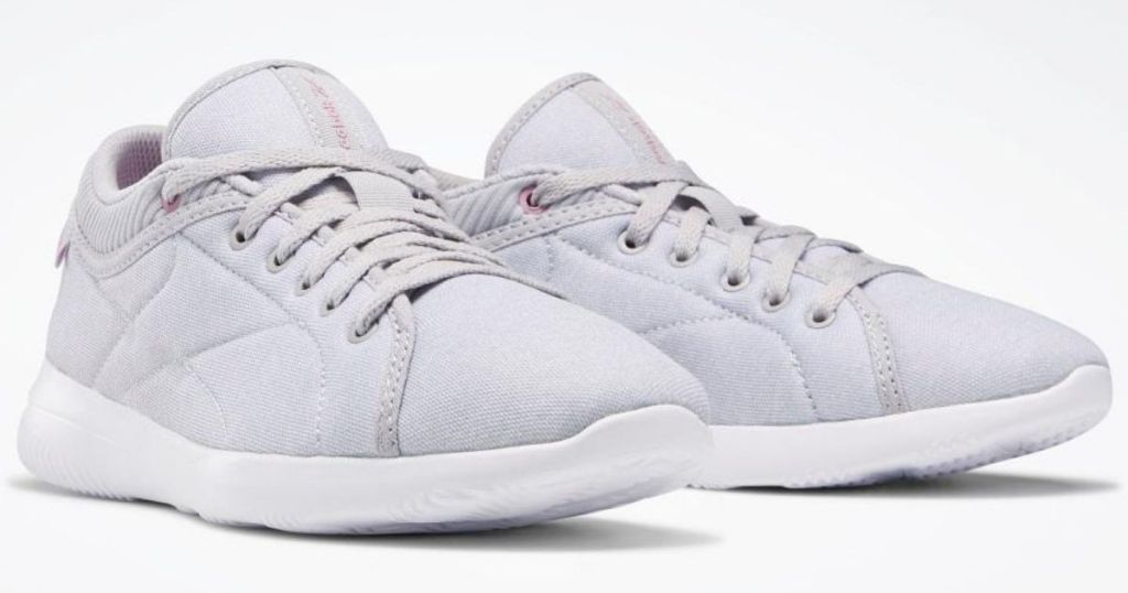 pair of grey Reebok sneakers
