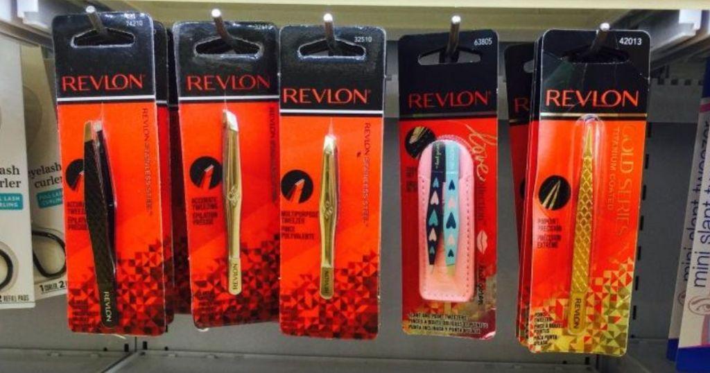 packs of revlon tweezers hanging