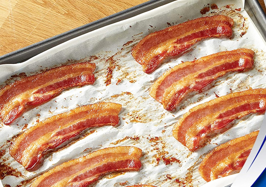 sheet pan lined with parchment paper with strips of cooked bacon on it