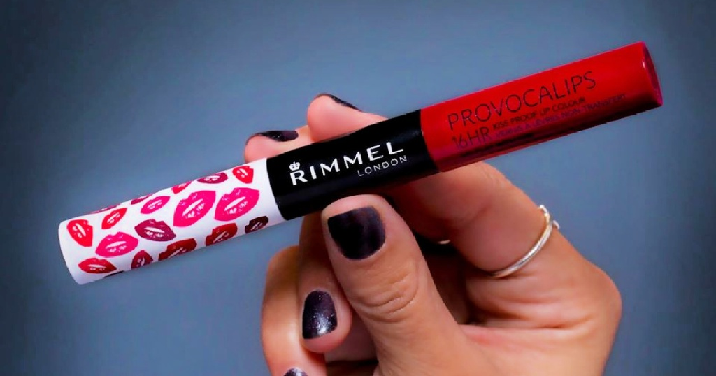 hand holding a Rimmel Provocalips 16hr Kissproof Lipstick Kiss Me You Fool
