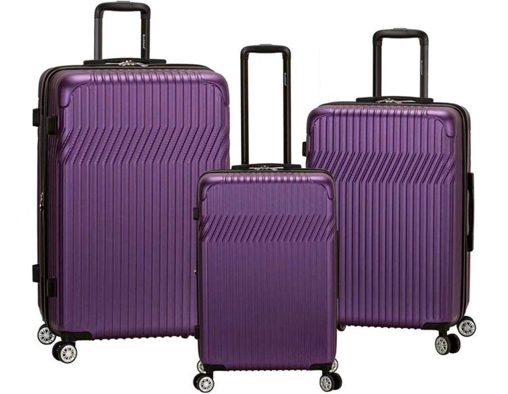 three piece purple hard side luggage set