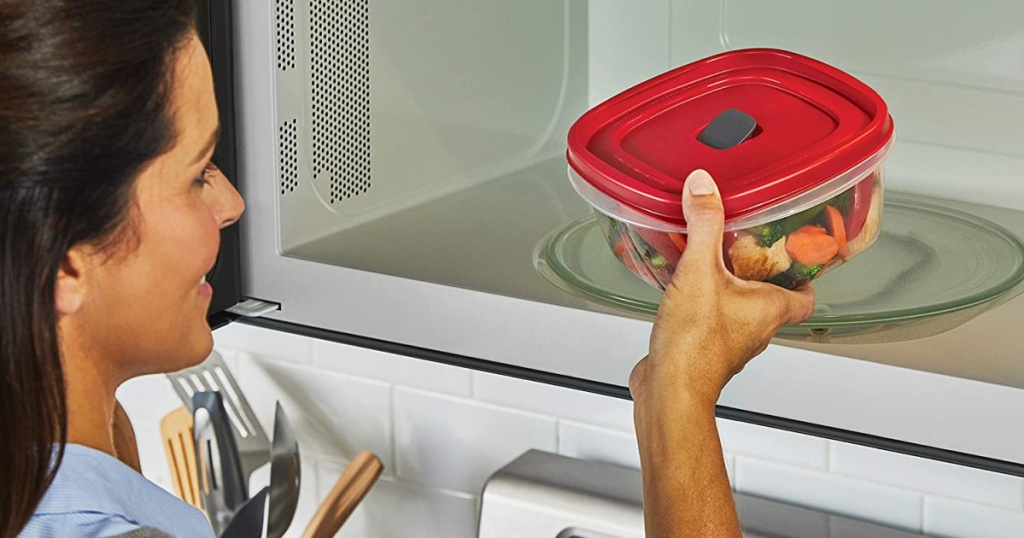 woman putting rubbermaid container in microwave