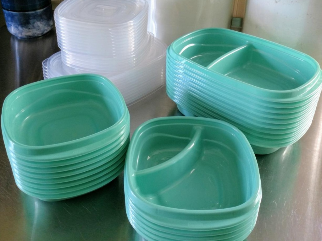 teal stackable containers and lids