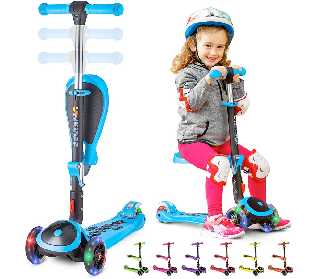 blue adjustable scooter with seat and led wheels with girl sitting on scooter seat wearing helmet