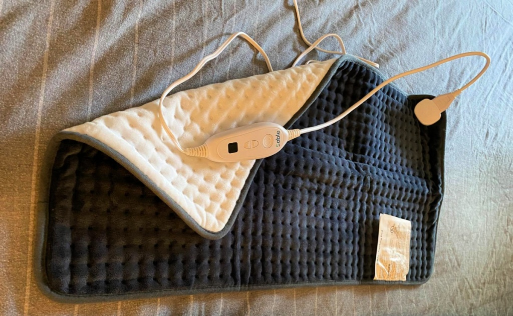 This heating pad is HUGE!!! I absolutely love it! I love the different heat settings also as sometimes a heating pad can get too hot too fast. This heating pad comfortably covers my entire back which is where I need the relief the most. The fabric is nice and soft too. I would definitely recommend this product!