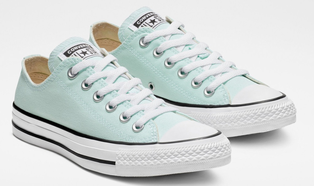 light blue pair of converse shoes