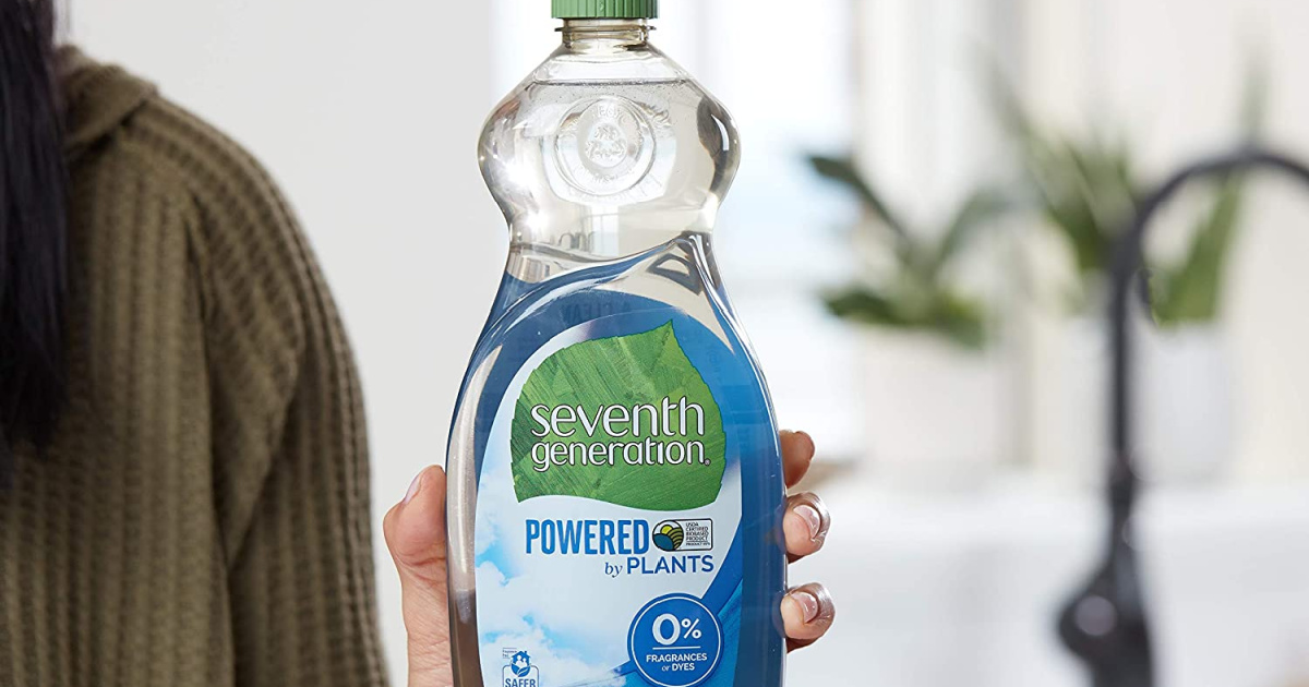hand holding Seventh Generation Free & Clear Dish Liquid Soap