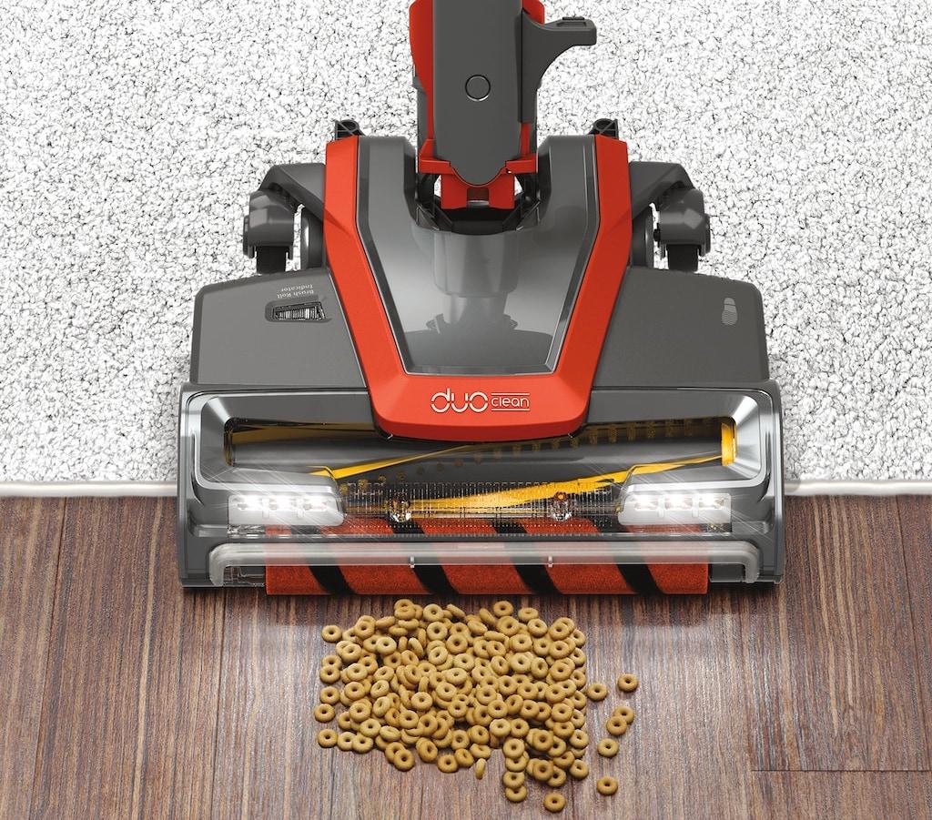 vacuum cleaning up cheerios