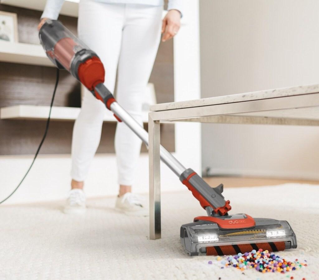 woman vacuuming up beads