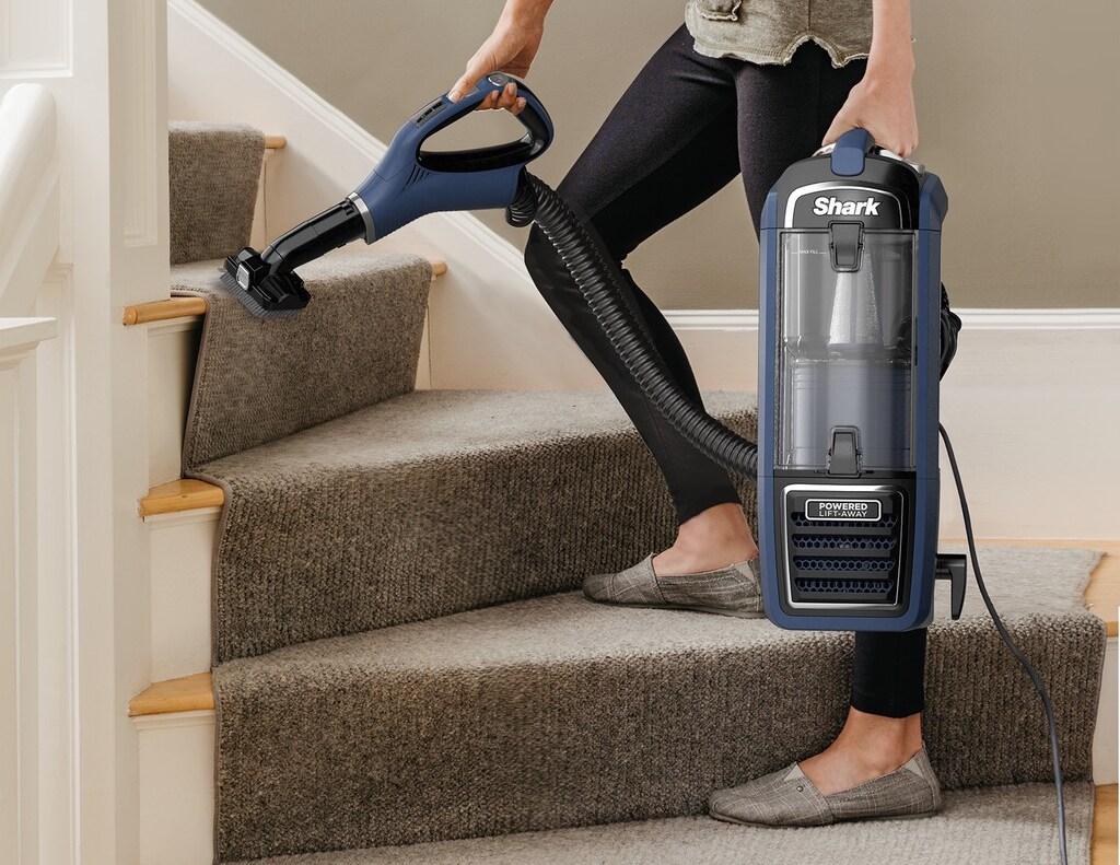 woman vacuuming stairs