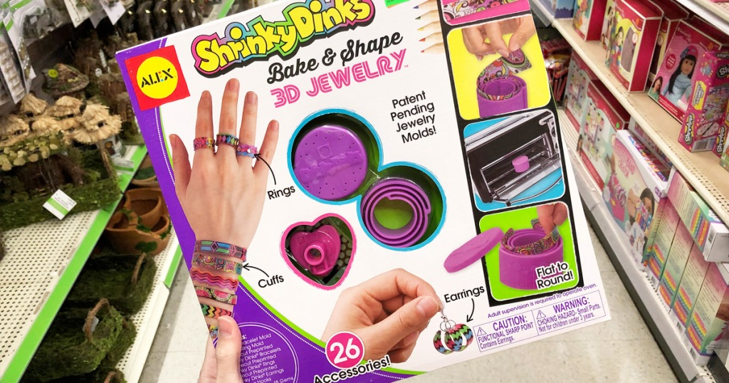 person holding up a Shinky Dinks 3D Jewelry kit box