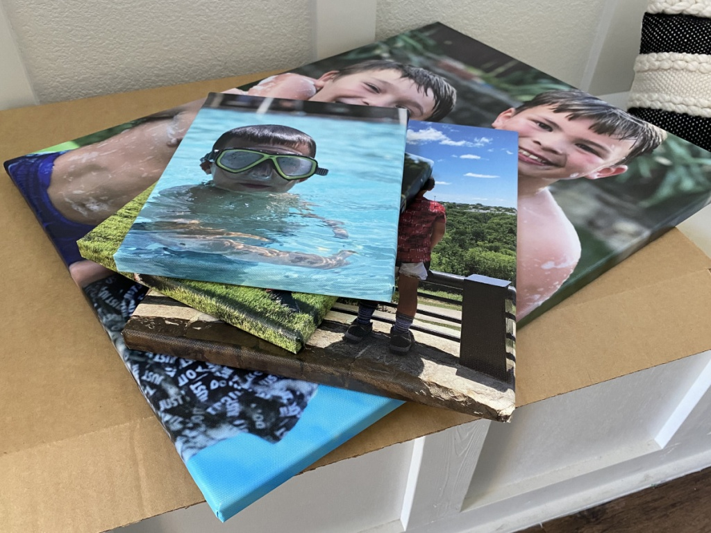 3 large canvas prints stacked on top on each other