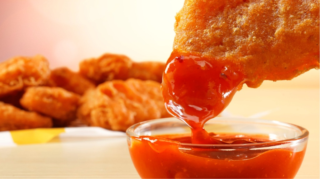 Spicy Chicken McNuggets dipped in sauce