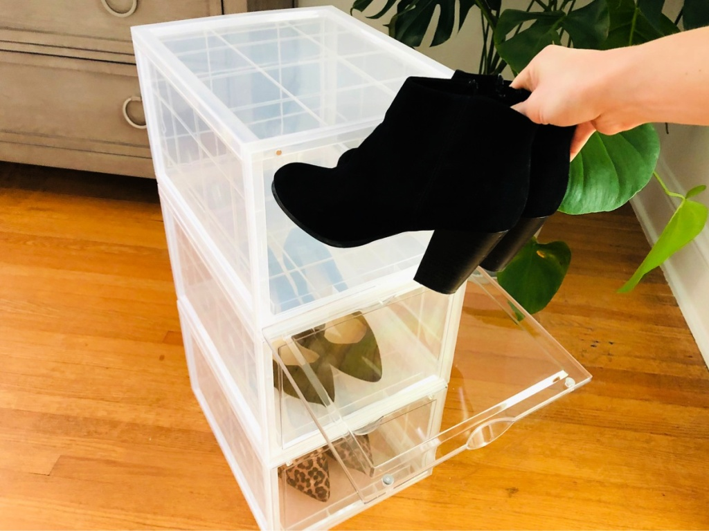 putting boots into Stackable Set of 3 Shoe Box Organizer