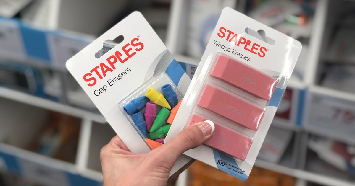 hand holding staples erasers
