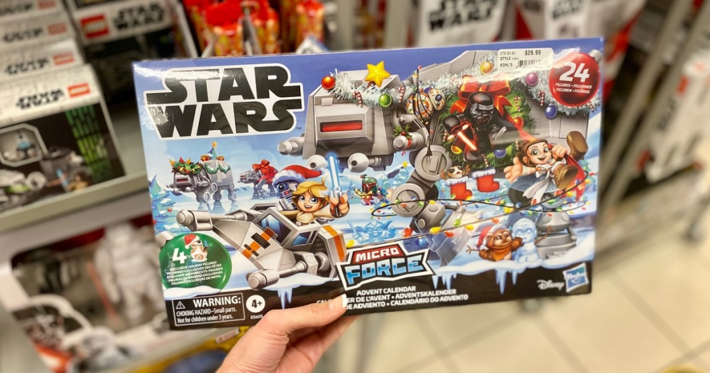 womans hand holding Star Wars advent calendar in store