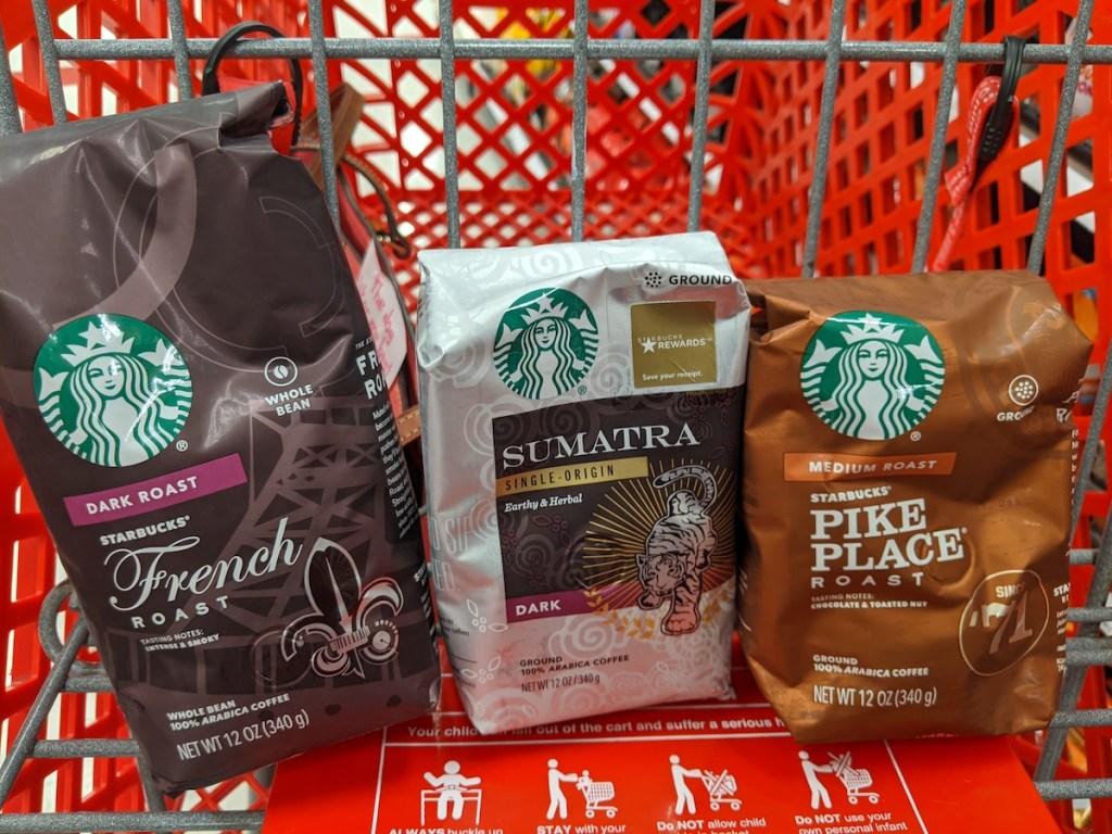 three bags of starbucks coffee in cart at target