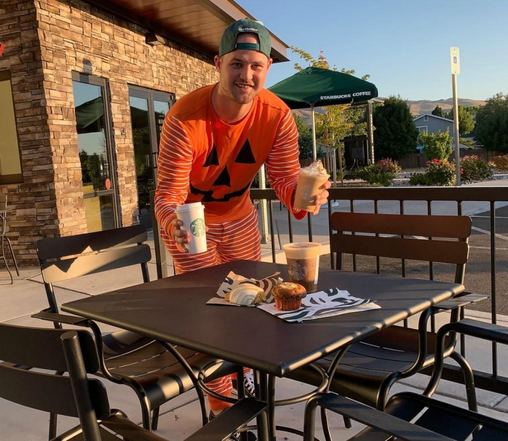 man wearing pumpkin pajamas at Starbucks