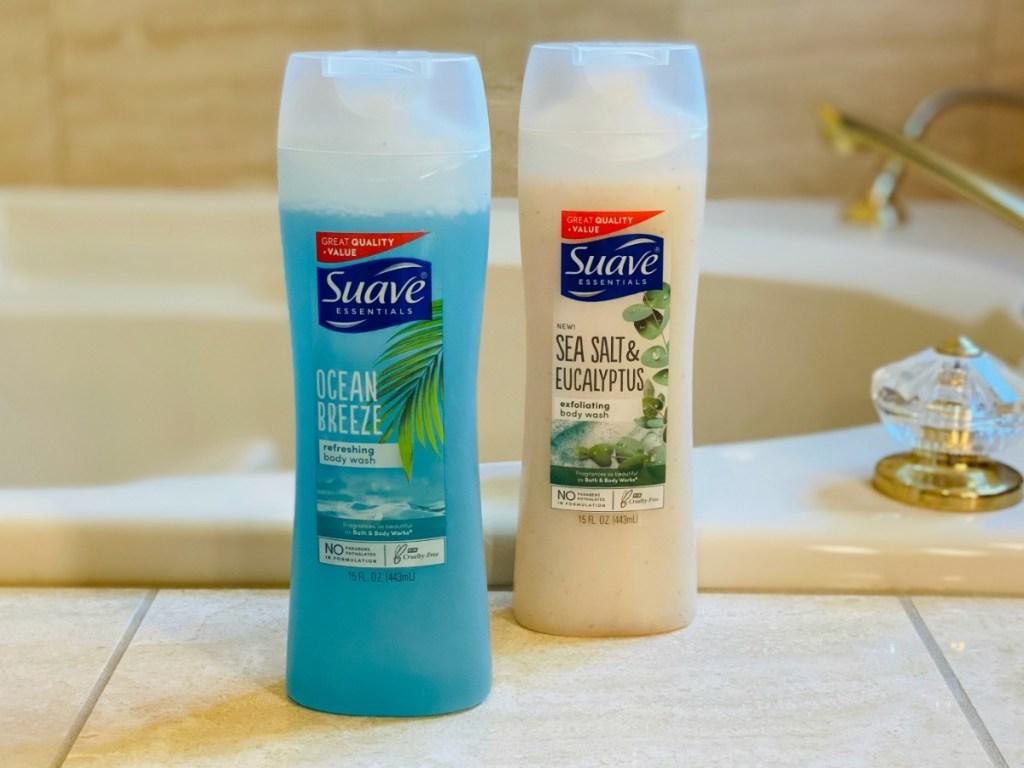 Suave Body wash bottles on bathtub shelf
