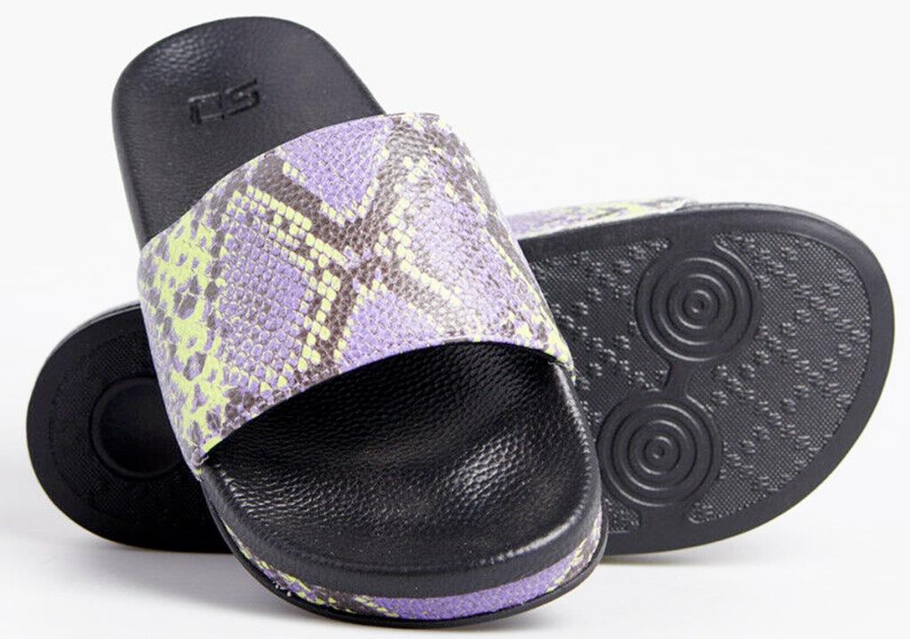 pair of women's purple snakeskin slides with black rubber soles