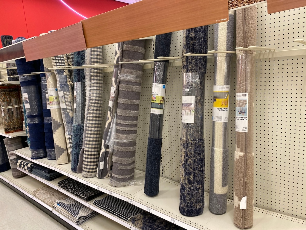 multiple Target Room Essentials Rugs on shelf at target