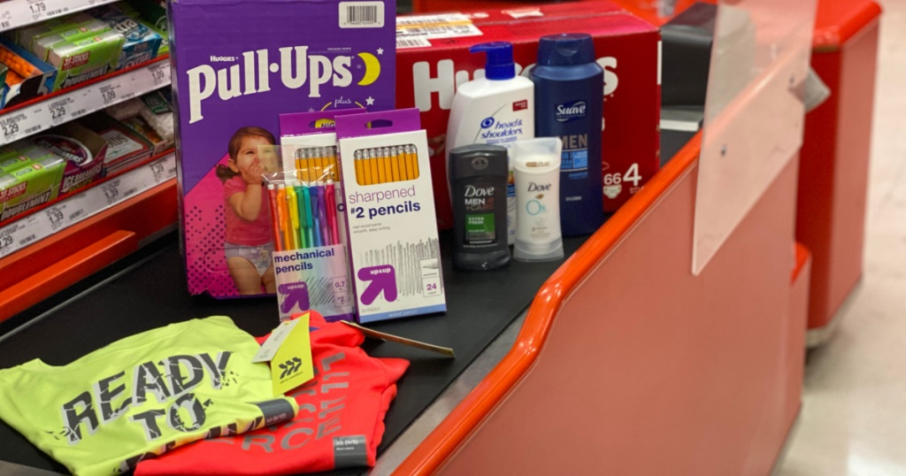 target check out lane with pull ups, huggies, school products, beauty products, and kids athletic clothes