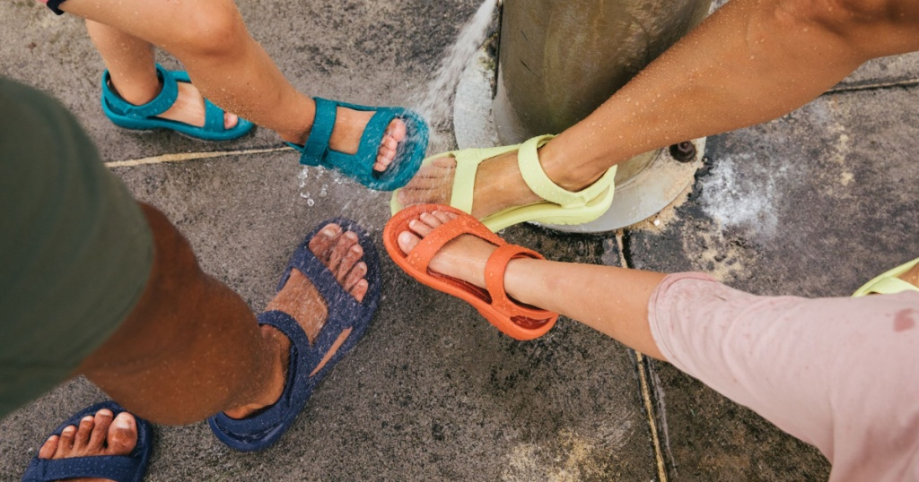 family wearing different colored sport sandals