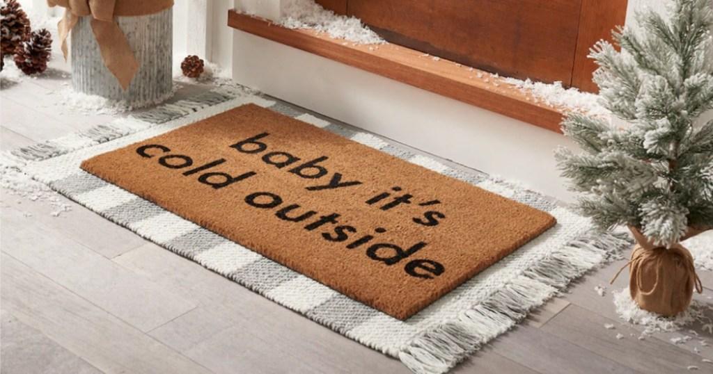 rug under a door mat by a front door