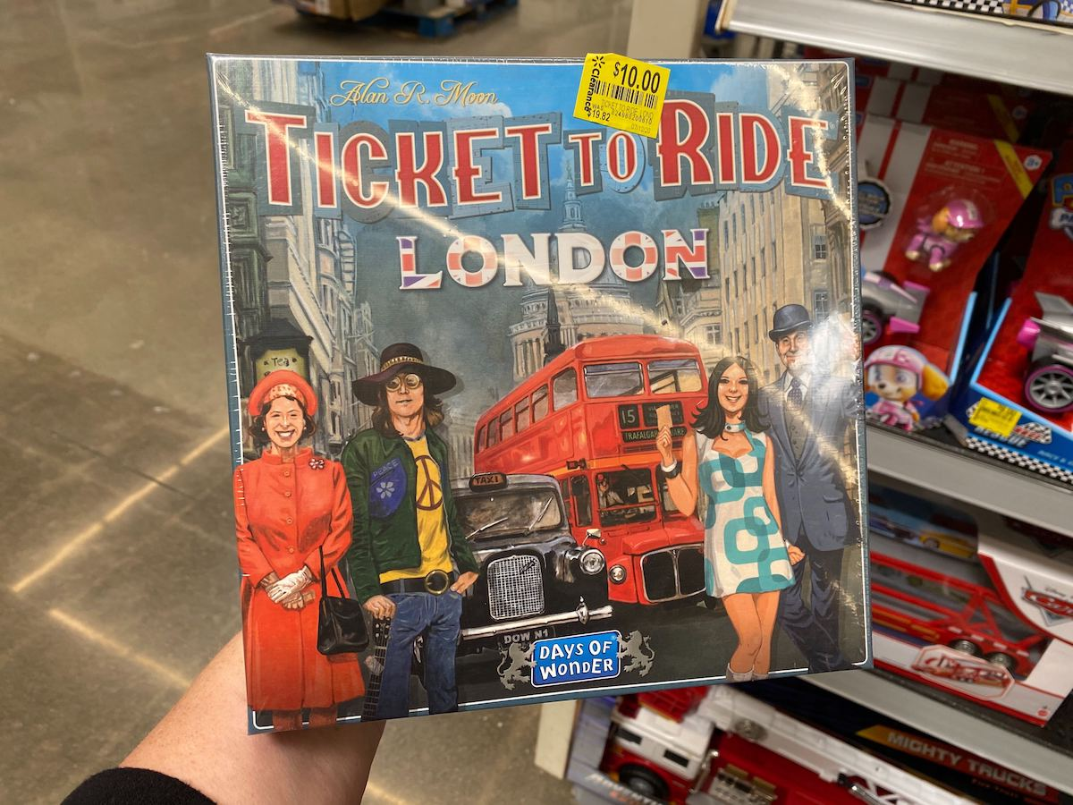hand holding Ticket to Ride London board game box in store