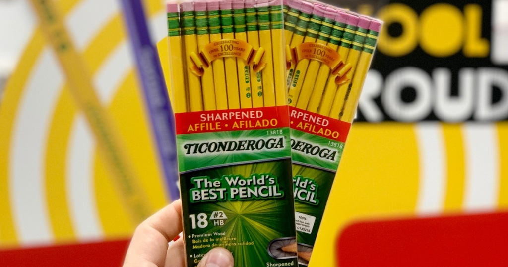 person holding up two 18-packs of yellow Ticonderoga pencils