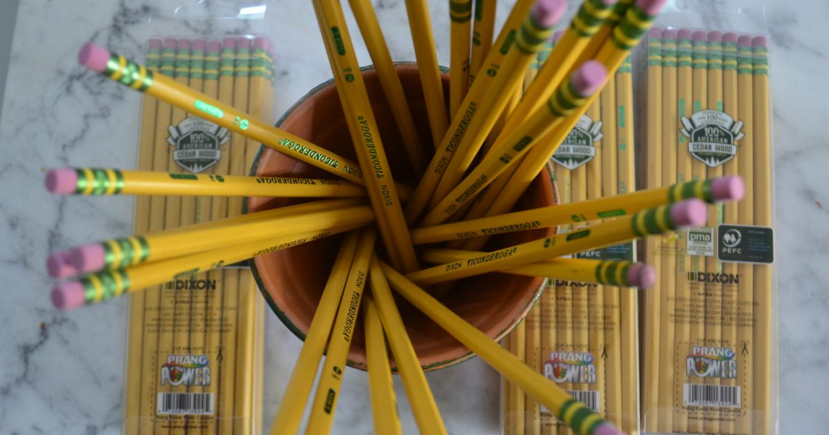 pencils in cup and packages of pencils on table