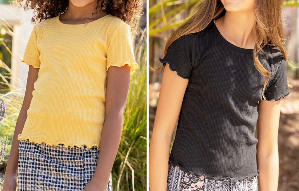 two girls wearing solid colored yellow and black tees with ruffle hems