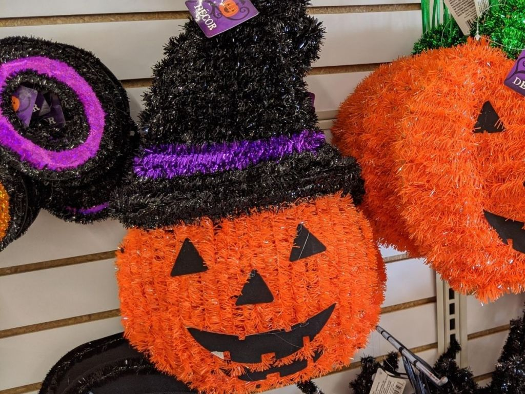 Tinsel pumpkin with witch hat on