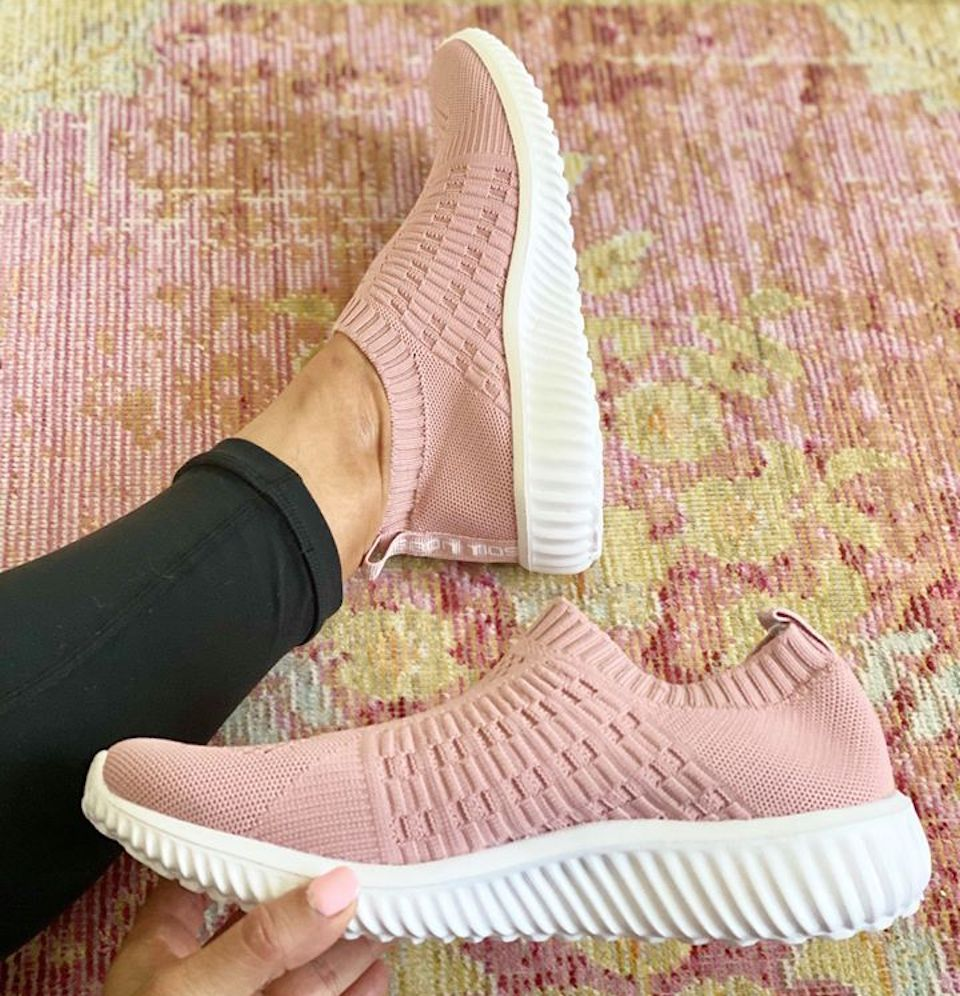 hand holding a pink shoe