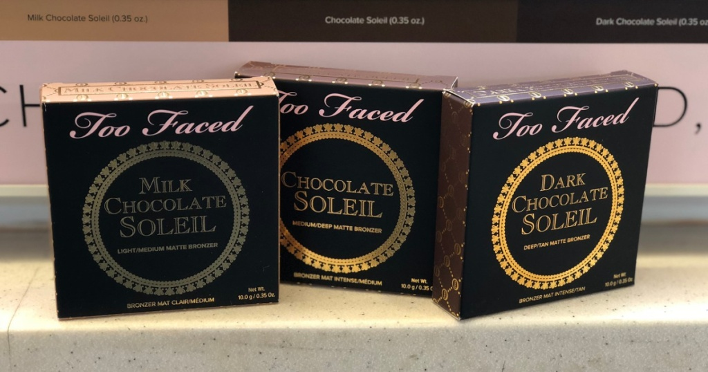 three bronzers in packages on counter in store