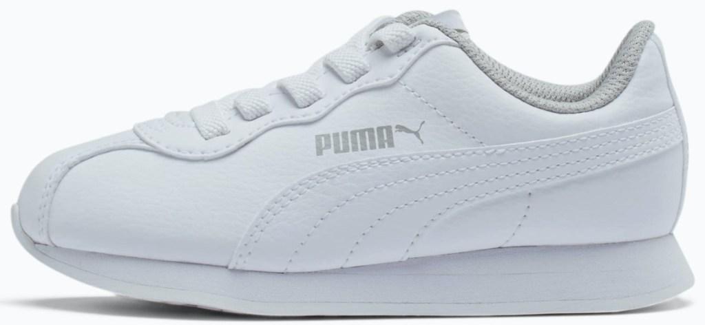 white pair of puma shoes
