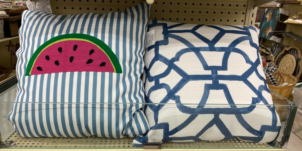 two pillows on shelf at Hobby Lobby