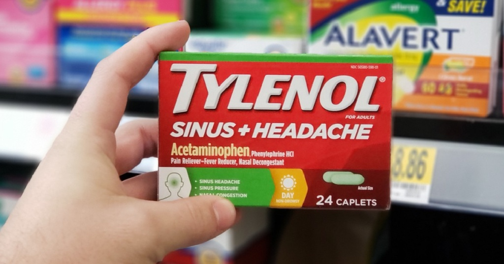 hand holding box of sinus medicine in store
