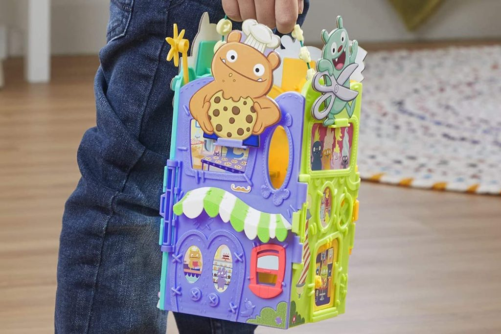 kid carrying an Uglyville Play Set