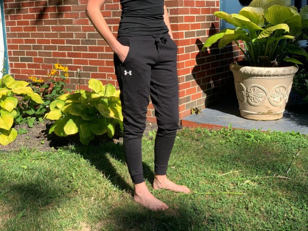 Woman wearing Black Under Armour sweat pants