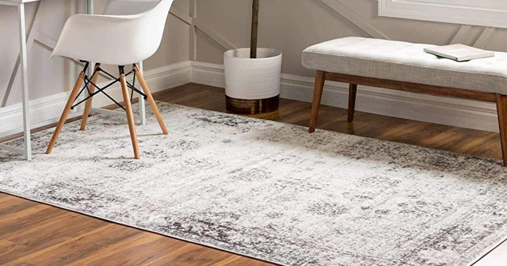cream and gray colored area rug on hardwood floor in home office