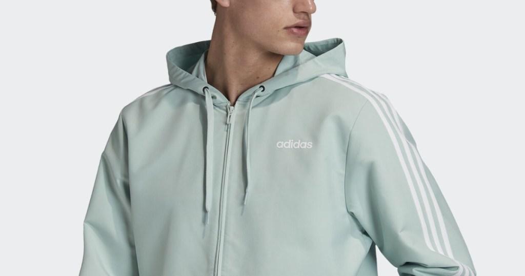 adidas 3-stripe jacket on guy mint green