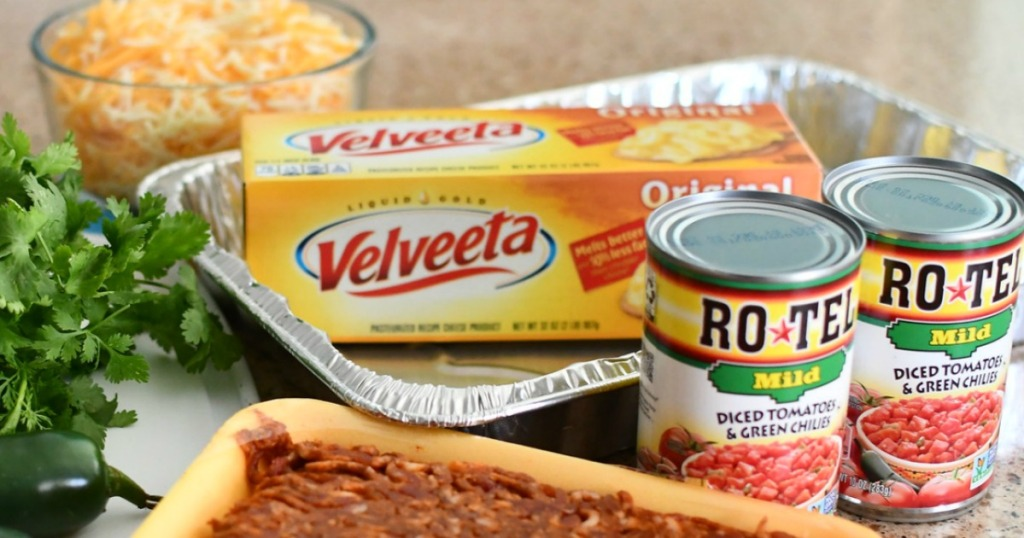 Velveeta Cheese Dip shown with rotel and other dip ingredients