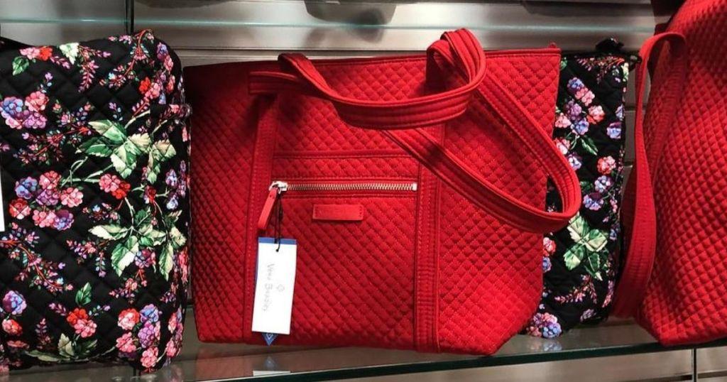 vera bradley bags on shelf