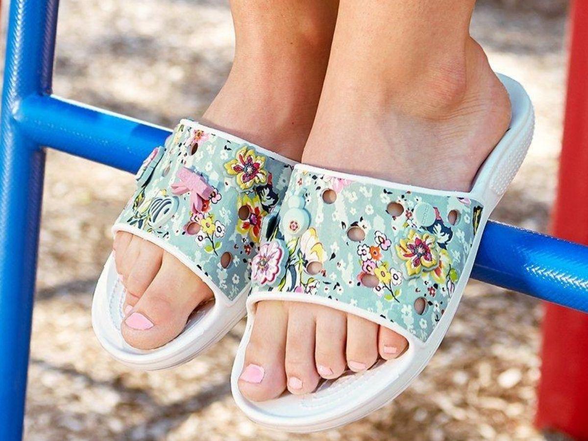 woman wearing garden slides in a floral pattern