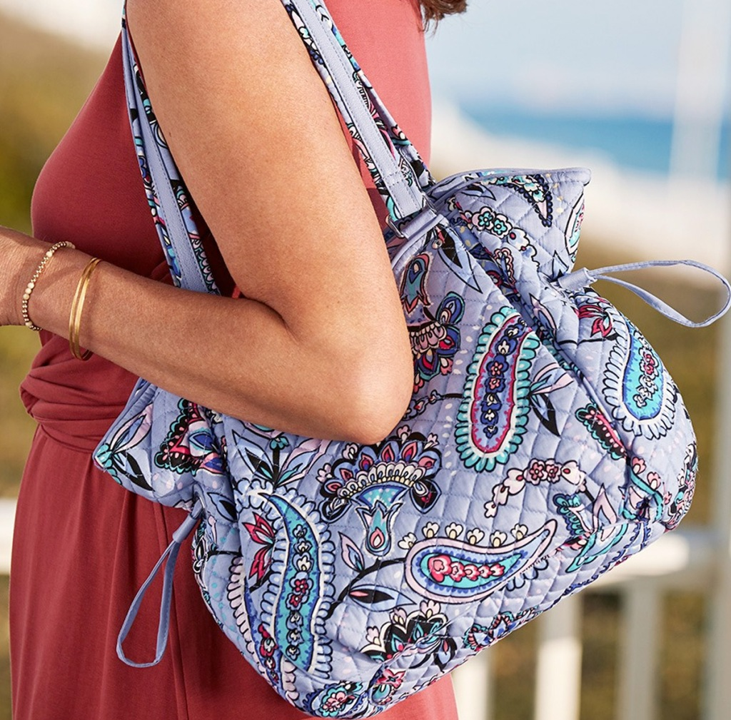 women with a light purple paisley print tote bag on her shoulder